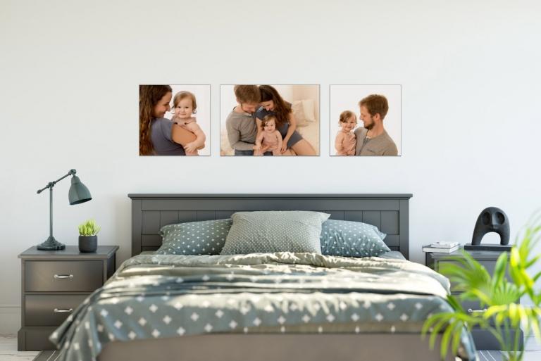 Babyfotos an der Wand als Erinnerung an die Babyzeit